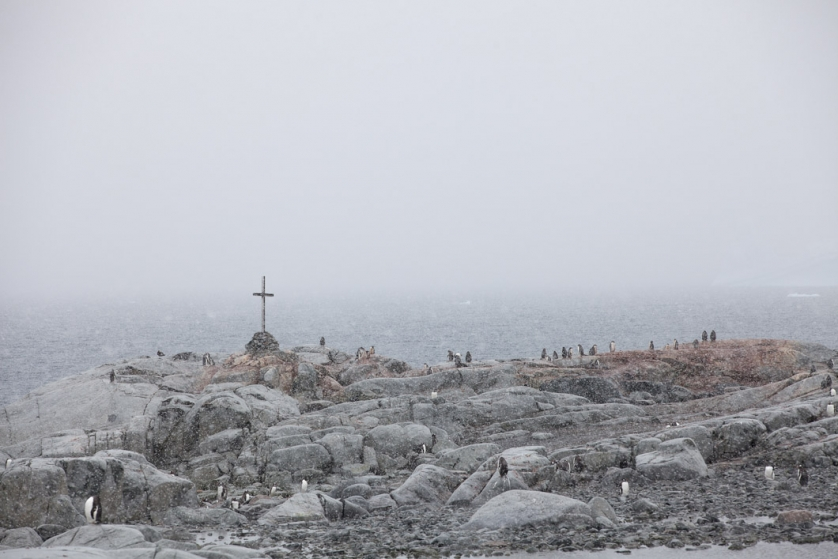 A memorial cross erected to honour the deaths of British Antarctic Survey members Ambrose C Morgan, Kevin P Ockleton and John Coll, who died on the 14th August 1982,  after the sea ice that they were crossing broke up during a field trip.