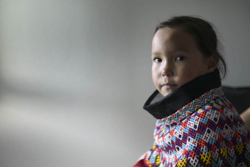 Lara, a Greenlandic Inuit, pictured on the day before her first day at school, wearing national dress made by her grandmother. It is a custom in Greenland schoolchildren wear national dress on their first day.