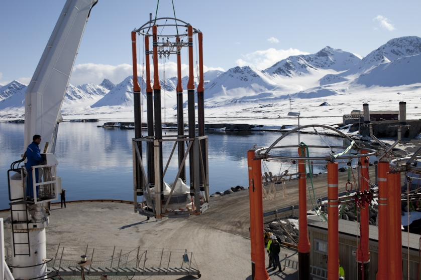 The mesocosms which will be used in the experiment are temporarily unloaded on the quayside at Ny-Alesund to be setup for istallation in the fjord.