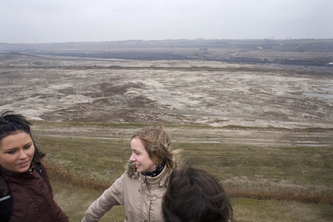 Three Polish women from the Konin area, who have attended a protest about land that will be occupied by the expansion of a mine, the second biggest in Poland. They stand on the edge of the Jozwin II B pit, part of the Konin mine complex, which is owned by KBW Konin.