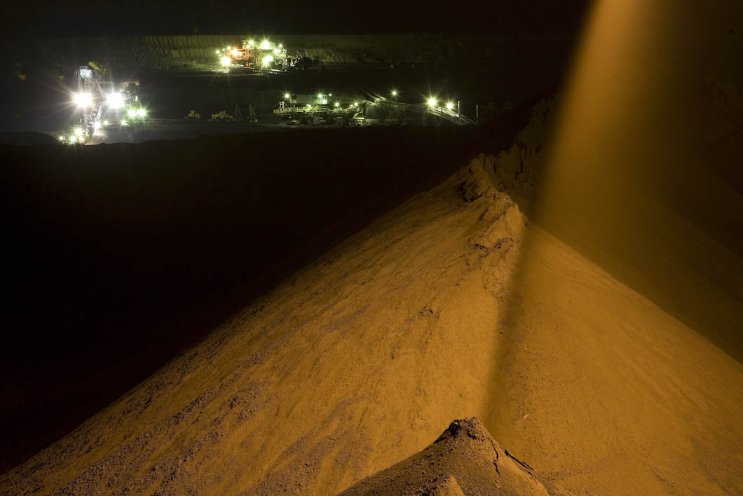 Earth displaced, by open-cast mining for coal, is moved, at night inside the Jozwin II B pit, an open cast mine that is part of the Konin mine complex in Poland, owned by Kopalnia Wegla Brunatnego (KWB). The mines here extract a type of coal called Lignite, which many refer to as 'brown coal'. Poland is dependent on coal for 93% of it's energy generation, via coal fired power stations, which are often located next to the mining areas.