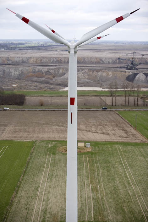 A view across the workings of part of the Konin mines of Western Poland, photographed from the wind turbine installed by Marek Matuszak. One of the wind turbines is in the foreground. Stopped now but due to be in operation in one month from the time of the visit. Marek owns three turbines in total, all built on his own land.