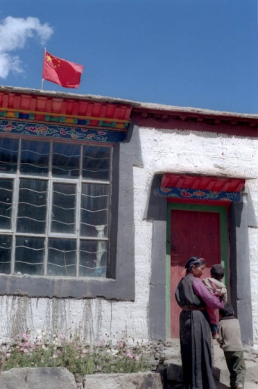 A housing development built for loyal Tibetans by the Chinese authorities, flies the flag of China.