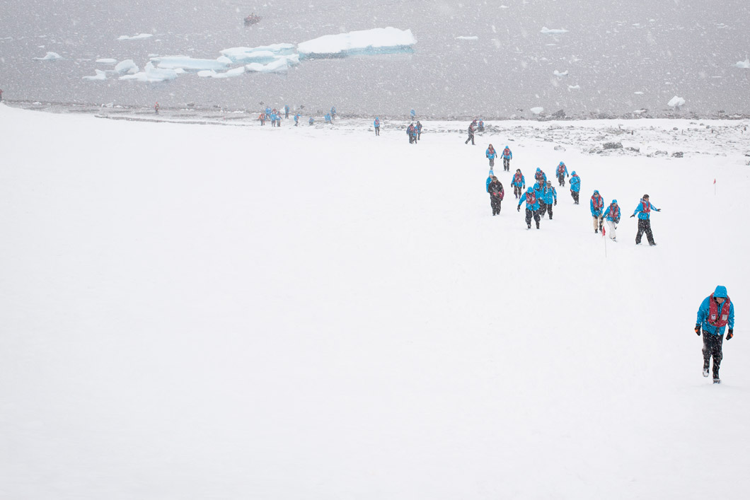Cruise ship passengers in Antarctica © Nick Cobbing